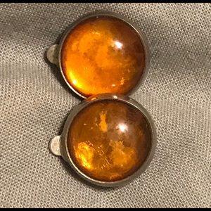 Amber clip on earrings set in silver.